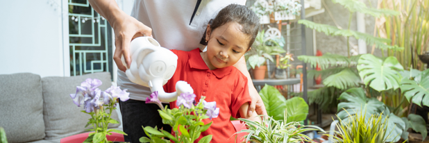 9 - Child watering a garden - Canva