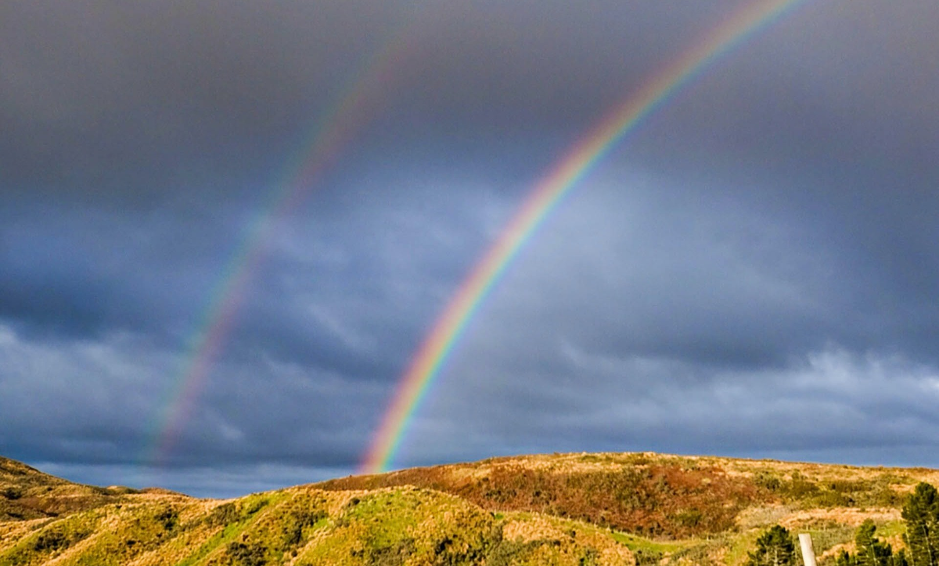 Double rainbow above the hills